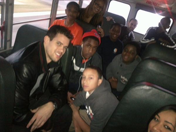 Kris on the school bus with UrbanPromise students
